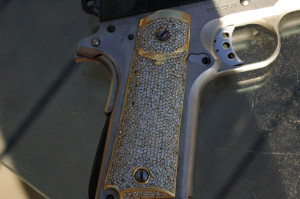 Gold and diamond 1911 grips.